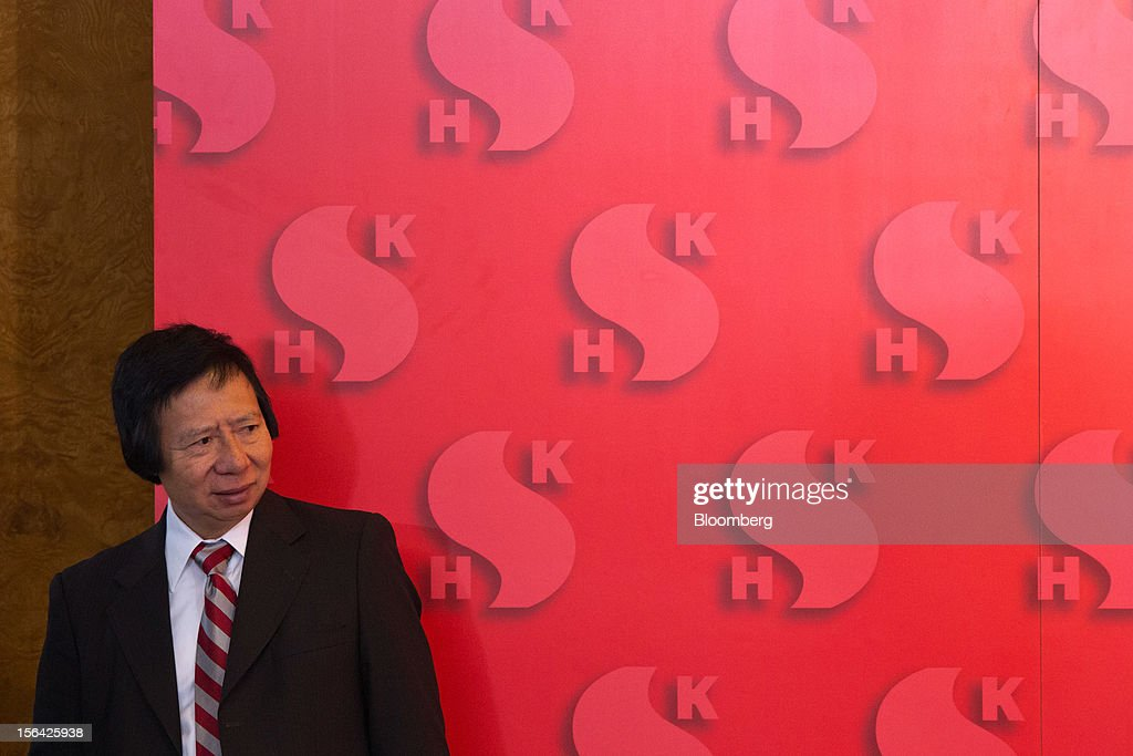 Thomas Kwok, co-chairman of Sun Hung Kai Properties Ltd., stands after a news conference in Hong Kong, China, on Thursday, Nov. 15, 2012. Sun Hung Kai will continue buying land in Hong Kong, says Thomas Kwok. Photographer: Lam Yik Fei/Bloomberg via Getty Images