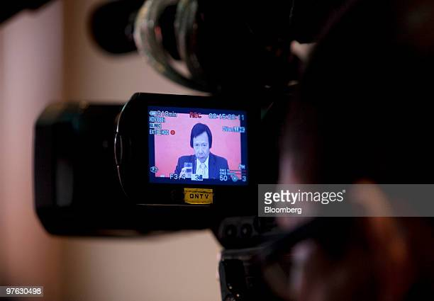 Thomas Kwok vice chairman of Sun Hung Kai Properties Ltd is seen on a video camera screen as he speaks during the company's interim results press...