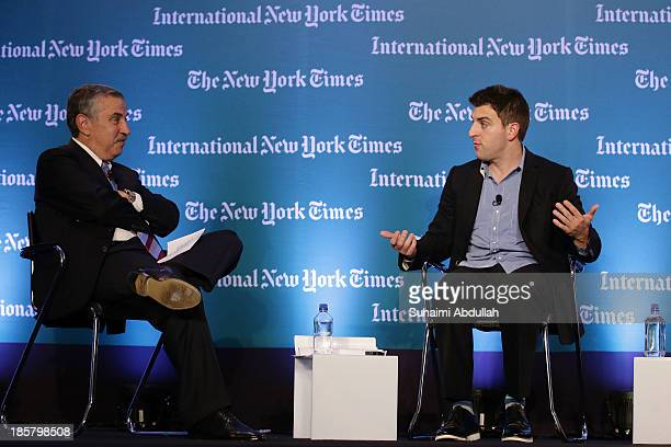 Thomas L Friedman OpEd columnist The New York Times speaks with Brian Chesky CEO and CoFounder AirBNB during the International New York Times Global...
