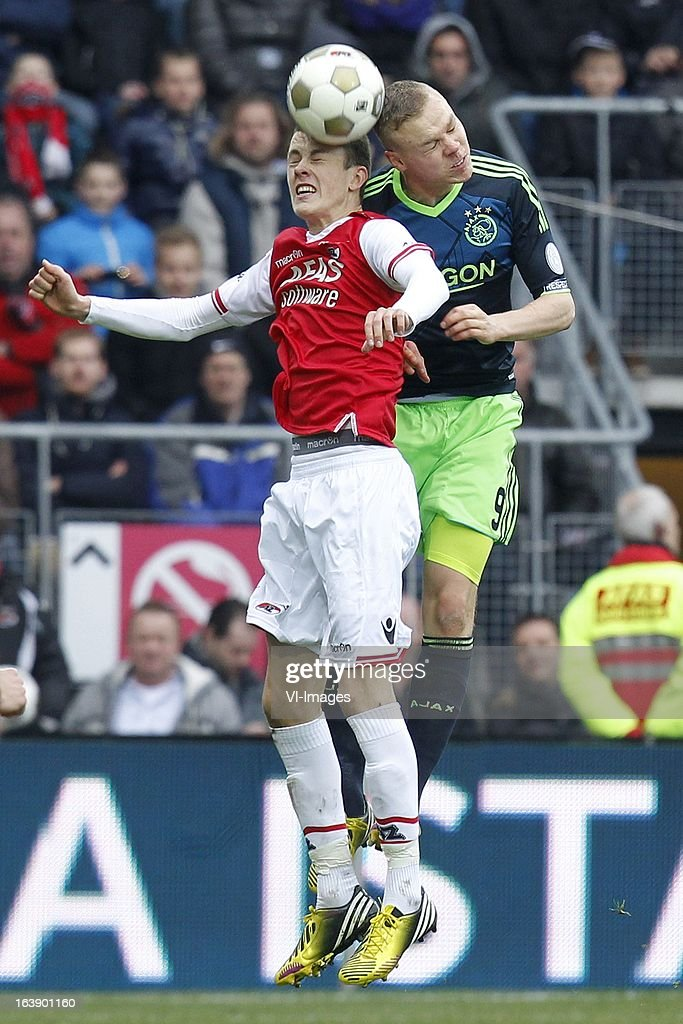 Thomas Lam of AZ (L), Kolbeinn Sigthorsson of Ajax (R) during the Dutch Eredivisie match between AZ Alkmaar and Ajax Amsterdam at the AFAS Stadium on march 17, 2013 in Alkmaar, The Netherlands