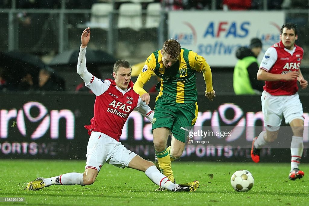 Thomas Lam of AZ , Tom Beugelsdijk of ADO Den Haag during the Dutch Eredivisie match between AZ Alkmaar and ADO Den Haag at the AFAS Stadium on march 09, 2013 in Alkmaar, The Netherlands