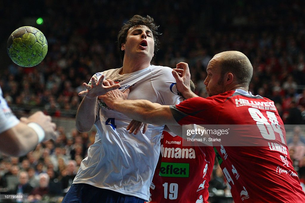 Thomas Lammers (R) of Ahlen-Hamm tackles Domagoj Duvnjak of Hamburg during the Toyota Handball Bundesliga match between HSG Ahlen-Hamm and HSV Hamburg at the Westfalenhalle on December 28, 2010 in Dortmund, Germany.