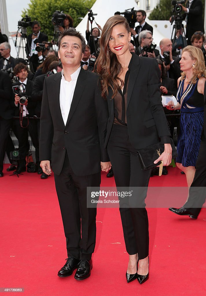 Thomas Langmann and Celine Bosquet attend the 'Saint Laurent' premiere during the 67th Annual Cannes Film Festival on May 17 2014 in Cannes France