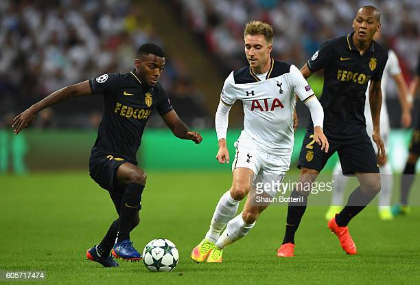 Thomas Lemar of AS Monaco is watched by Christian Eriksen of Tottenham Hotspur during the UEFA Champions League match between Tottenham Hotspur FC...