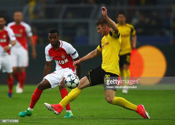 Thomas Lemar of AS Monaco passes under pressure from Lukasz Piszczek of Borussia Dortmund during the UEFA Champions League Quarter Final first leg...