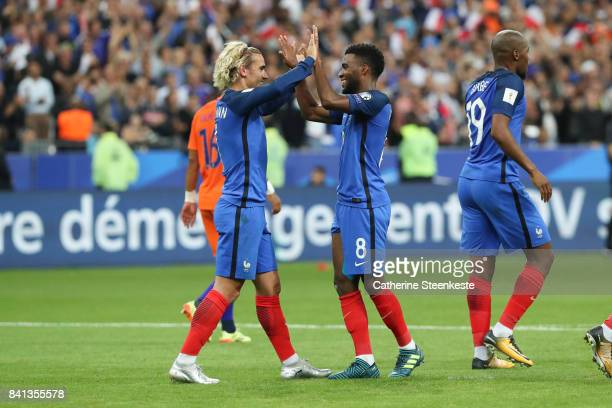 Thomas Lemar of France celebrates his goal with Antoine Griezmann who passed him the ball during the FIFA 2018 World Cup Qualifier between France and...