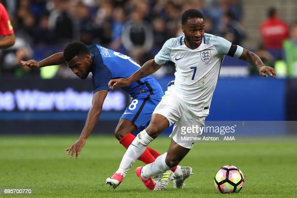 Thomas Lemar of France competes with Raheem Sterling of England during the International Friendly match between France and England at Stade de France...