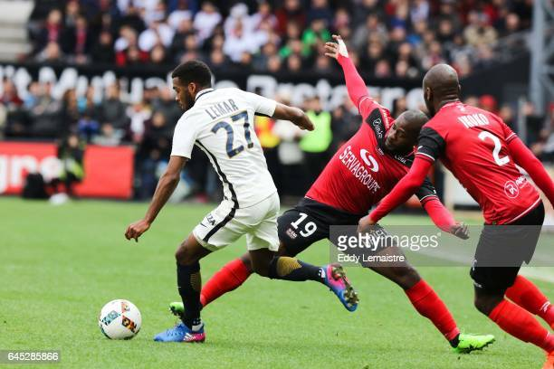 Thomas Lemar of Monaco and Yannis Salibur of Guingamp during the French Ligue 1 match between Guingamp and Monaco at Stade du Roudourou on February...