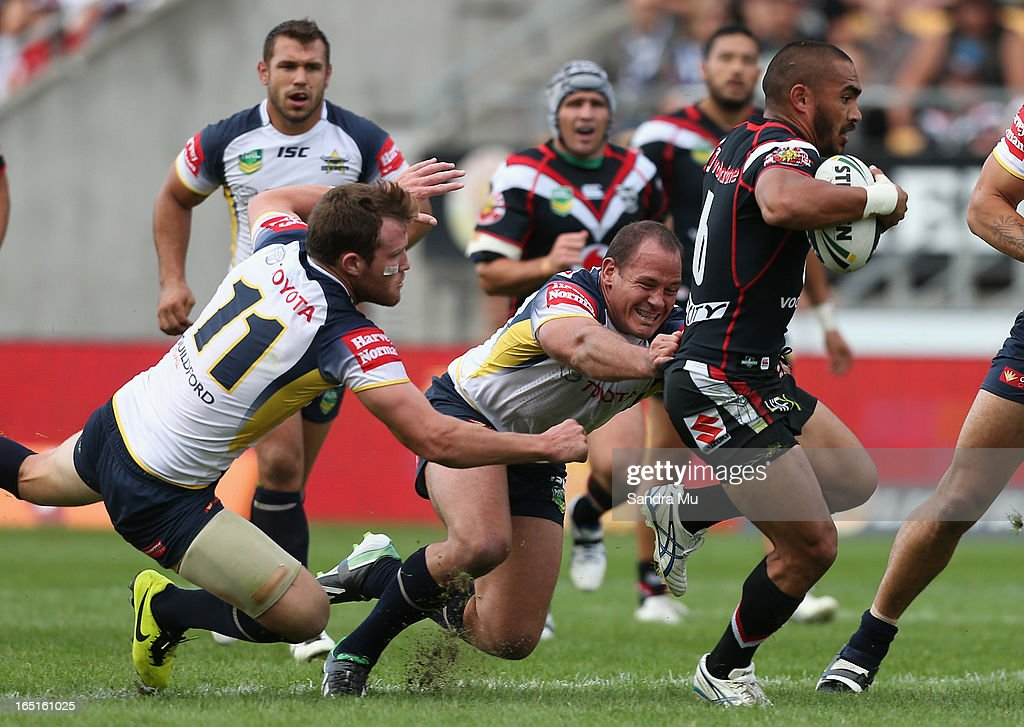 <a gi-track='captionPersonalityLinkClicked' href=/galleries/search?phrase=Thomas+Leuluai&family=editorial&specificpeople=650957 ng-click='$event.stopPropagation()'>Thomas Leuluai</a> of the Warriors is tackled during the round four NRL match between the New Zealand Warriors and the North Queensland Cowboys at Mt Smart Stadium on April 1, 2013 in Auckland, New Zealand.