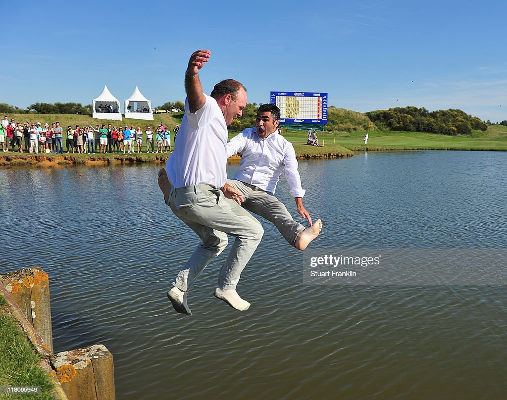 Thomas Levet of France and his manager Patrice Bartez jump into the lake on the 18th hole after winning The Open de France presented by Alstom at the...