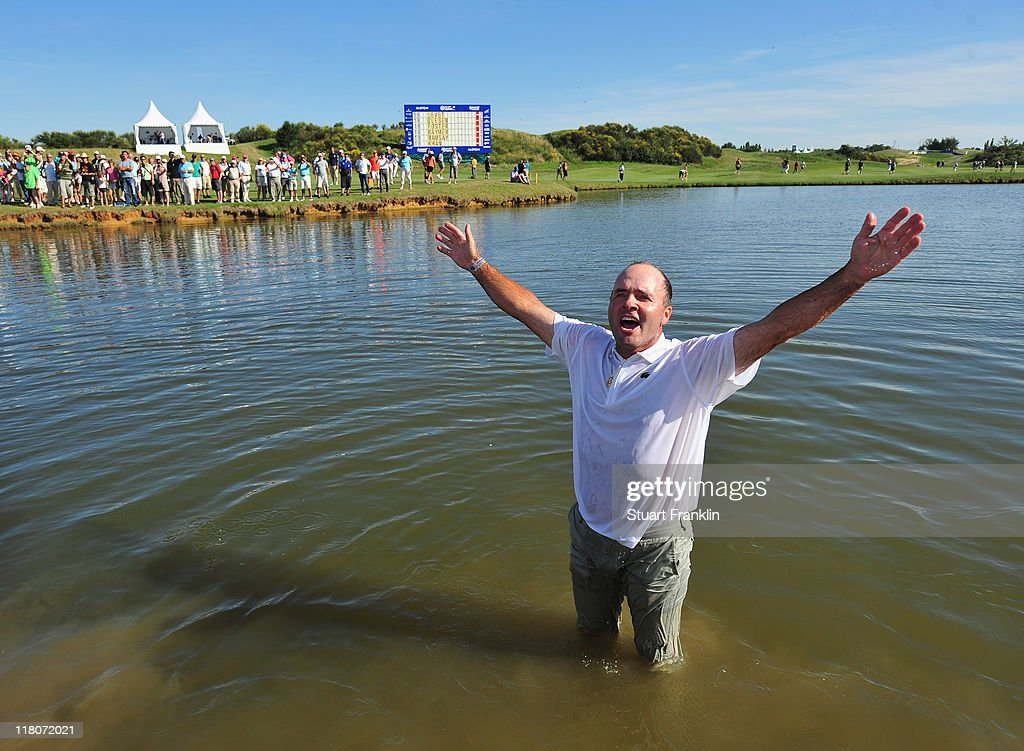 Thomas Levet of France celebrates after jumping into the lake on the 18th hole after winning The Open de France presented by Alstom at the Golf...