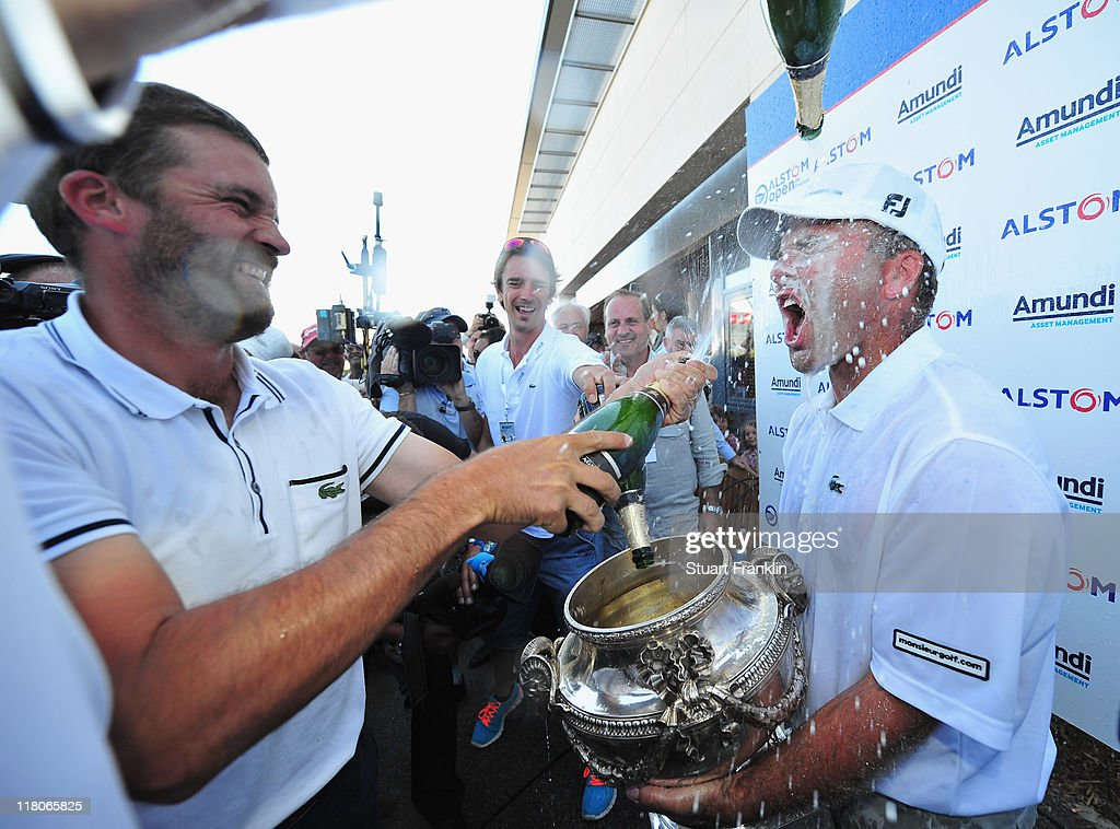 Thomas Levet of France is showered in champagne by Francois Delamontagne of France after being presented with the trophy for winning The Open de France presented by Alstom at the Golf National Golf Club on July 3, 2011 in Paris, France.