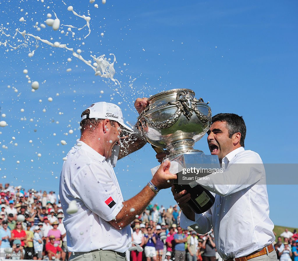 Thomas Levet of France is showered in champagne by his manager Patrice Bartezafter winning The Open de France presented by Alstom at the Golf...