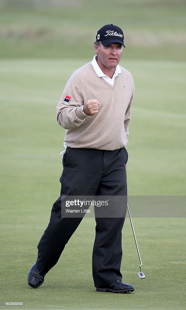 <a gi-track='captionPersonalityLinkClicked' href=/galleries/search?phrase=Thomas+Levet&family=editorial&specificpeople=203326 ng-click='$event.stopPropagation()'>Thomas Levet</a> of France reacts after holing a putt on the 15th green during the final round of the Alfred Dunhill Links Championship on The Old Course, at St Andrews on September 29, 2013 in St Andrews, Scotland.