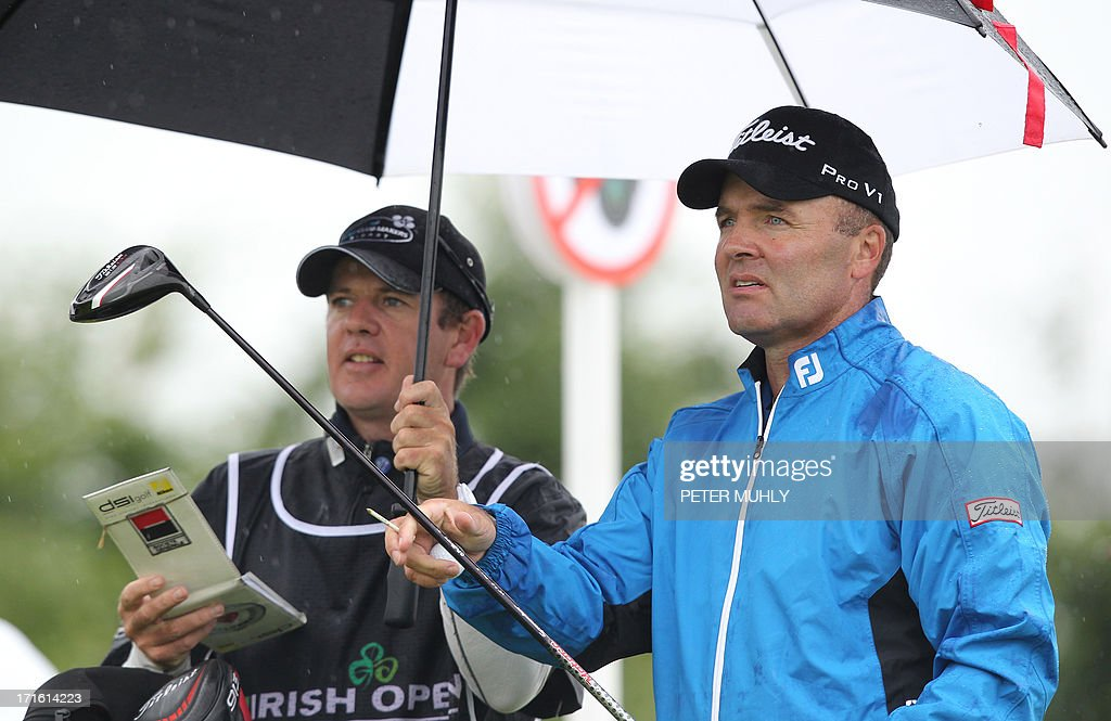 Thomas Levet (R) of France speaks with his caddy before teeing off on the fourth hole during the first round of the Irish Open golf championship at Carton House Golf Club, Maynooth, Ireland on June 27, 2013.