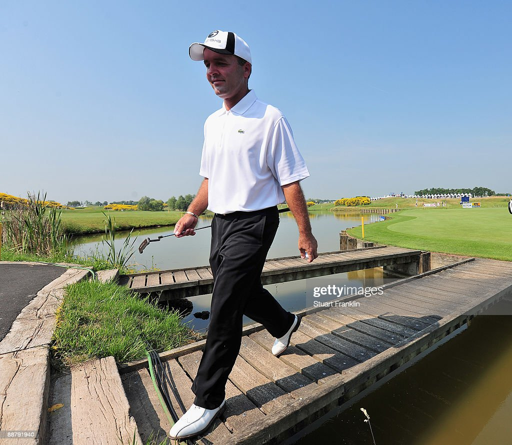 Thomas Levet of France walks over a bridge on the 18th hole during the first round of the Open de France ALSTOM at the Le Golf National Golf Club on...