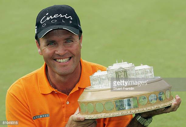 Thomas Levet of France with the trophy for winning The Barclays Scottish Open at Loch Lomond Golf Club on July 11 2004 in Loch Lomond Scotland