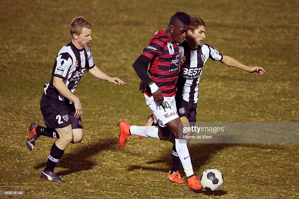 Thomas Love (R) of Adelaide City competes with Kwabena Appiah of Western Sydney during the FFA Cup match between Adelaide City and Western Sydney Wanderers at Marden Sports Complex on August 12, 2014 in Adelaide, Australia.