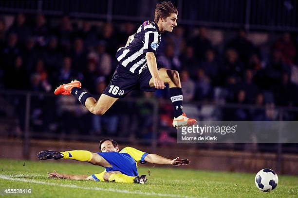 Thomas Love of Adelaide evades a tackle to win the ball during the FFA Cup match between Adelaide City and the Brisbane Strikers at the on September...
