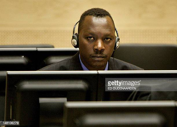 Thomas Lubanga sits with a headset over his ears 20 March 2006 is the first person to face trial for war crimes before the recently created...