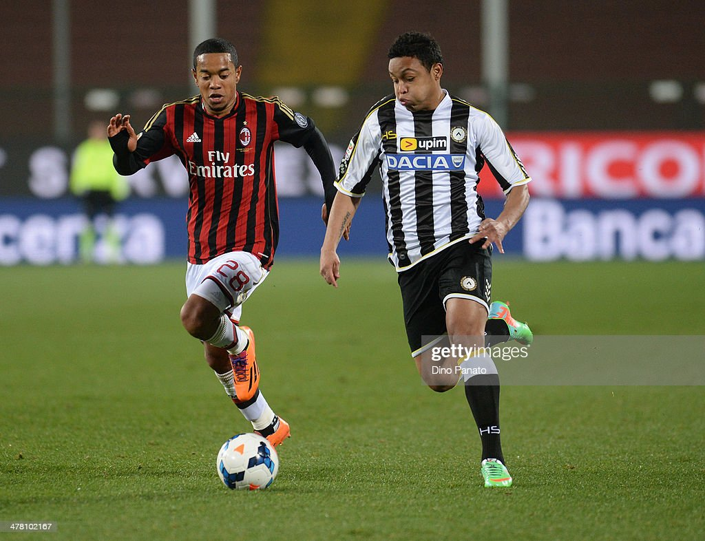 Thomas Luis Muriel (R) of Udinese Calcio competes with <a gi-track='captionPersonalityLinkClicked' href=/galleries/search?phrase=Urby+Emanuelson&family=editorial&specificpeople=594399 ng-click='$event.stopPropagation()'>Urby Emanuelson</a> of AC Milan during the Serie A match between Udinese Calcio and AC Milan at Stadio Friuli on March 8, 2014 in Udine, Italy.