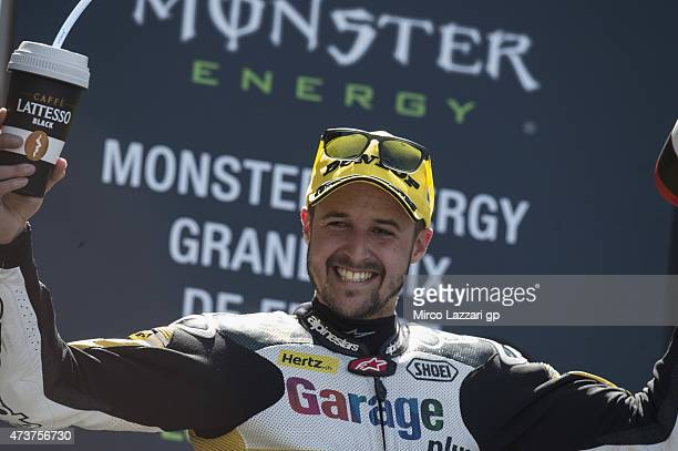 Thomas Luthi of of Switzerland and Derendinger Racing Interwetten celebrates the victory on the podium at the end of the Moto2 race during the MotoGp...