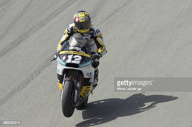 Thomas Luthi of of Switzerland and Derendinger Racing Interwetten lifts the front wheel during the MotoGp of Germany Free Practice at Sachsenring...