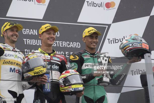 Thomas Luthi of Switzerland and Carxpert Interwetten Dominique Aegerter of Switzerland and Kiefer Racing and Hafizh Syahrin of Malaysia and Petronas...