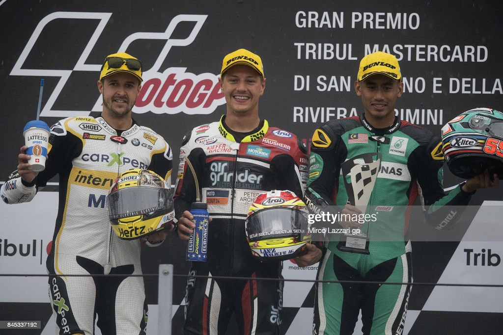 Thomas Luthi of Switzerland and Carxpert Interwetten; Dominique Aegerter of Switzerland and Kiefer Racing; and Hafizh Syahrin of Malaysia and Petronas Raceline Malaysia celebrate on the podium at the end of the Moto2 Race during the MotoGP of San Marino - Race at Misano World Circuit on September 10, 2017 in Misano Adriatico, Italy.