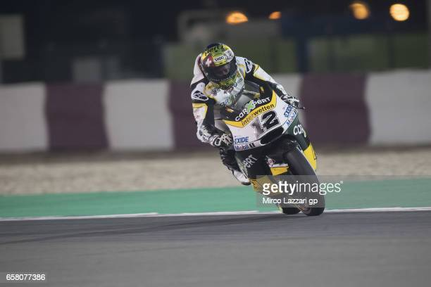Thomas Luthi of Switzerland and Carxpert Interwetten heads down a straight during the Moto2 race during the MotoGp of Qatar Race at Losail Circuit on...