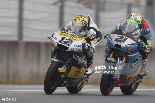 Thomas Luthi of Switzerland and Carxpert Interwetten leads Franco Morbidelli of Italy and EG 00 Marc VDS during the Moto2 race during the MotoGp of...