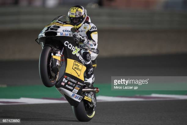 Thomas Luthi of Switzerland and Carxpert Interwetten lifts the front wheel during the MotoGp of Qatar Free Practice at Losail Circuit on March 24...