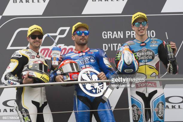 Thomas Luthi of Switzerland and Carxpert Interwetten Mattia Pasini of Italy and Italtrans Racing Team and Alex Marquez of Spain and EG 00 Marc VDS...