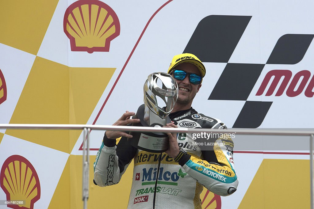 Thomas Luthi of Switzerland and Derendinger Racing Interwetten celebrates second place on the podium at the end of the Moto2 race during the MotoGP Of Malaysia at Sepang Circuit on October 25, 2015 in Kuala Lumpur, Malaysia.