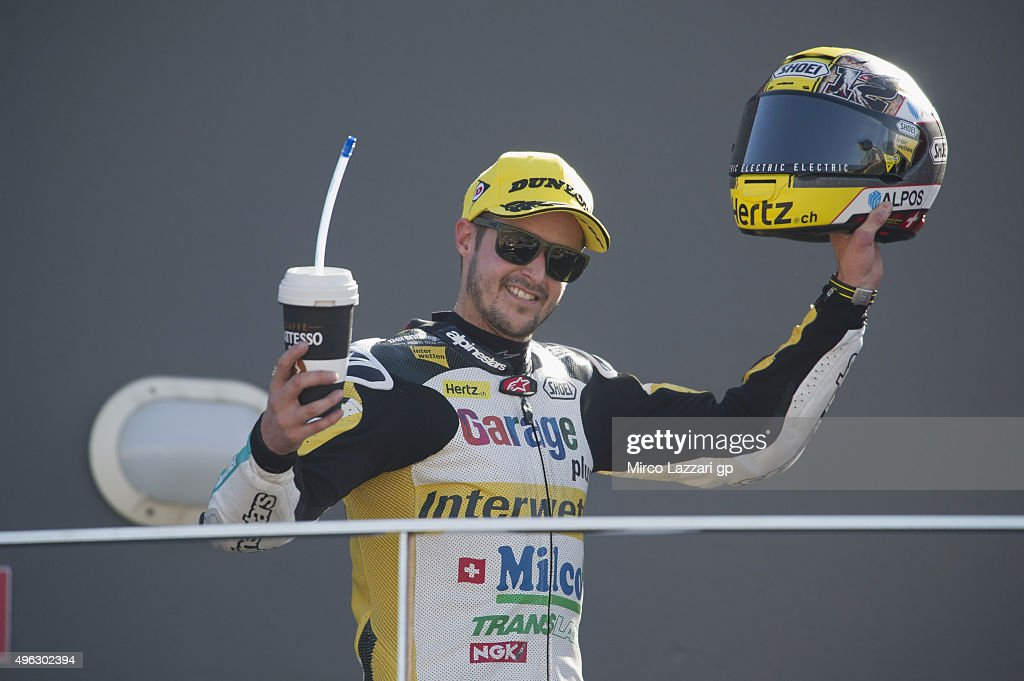 Thomas Luthi of Switzerland and Derendinger Racing Interwetten celebrates the third place on the podium at the end of the Moto2 race during the MotoGP of Valencia - Race at Ricardo Tormo Circuit on November 8, 2015 in Valencia, Spain.
