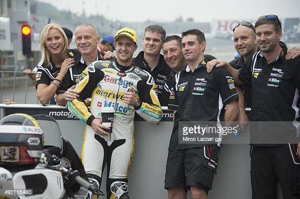 Thomas Luthi of Switzerland and Derendinger Racing Interwetten celebrates with team the second place at the end of the qualifying practice during the...