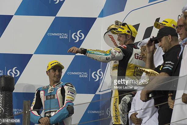 Thomas Luthi of Switzerland and Garage Plus Interwetten celebrates the Moto2 victory on the podium at the end of the Moto2 race during the MotoGp of...