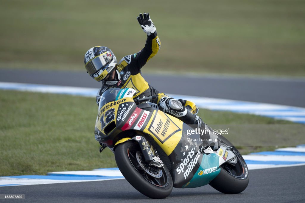Thomas Luthi of Switzerland and Interwetten Paddock celebrates the second place at the end of the Moto2 race ahead of the Australian MotoGP, which is round 16 of the MotoGP World Championship at Phillip Island Grand Prix Circuit on October 20, 2013 in Phillip Island, Australia.