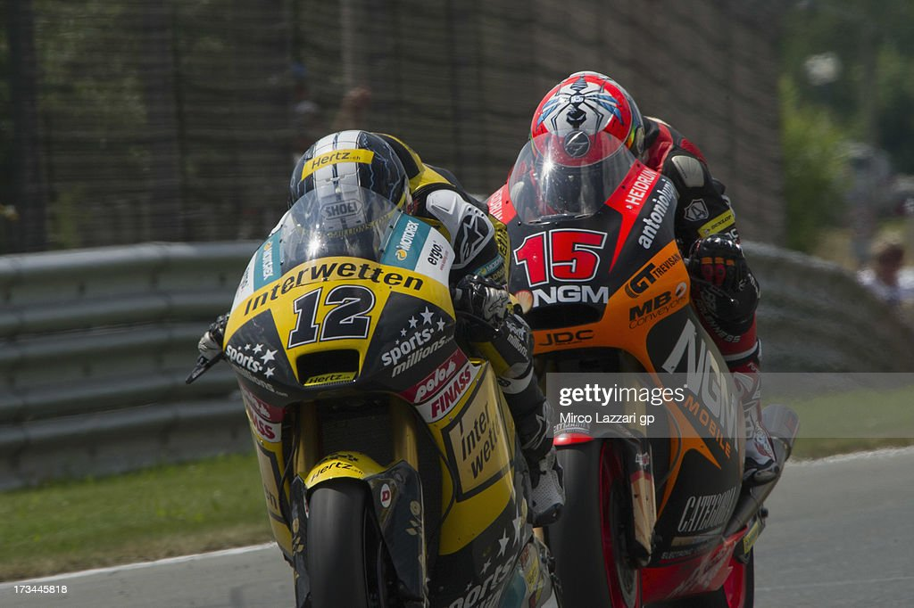 Thomas Luthi of Switzerland and Interwetten Paddock leads Alex De Angelis of San Marino and NGM Mobile Forward Racing during the Moto2 race during the MotoGp of Germany - Race at Sachsenring Circuit on July 14, 2013 in Hohenstein-Ernstthal, Germany.