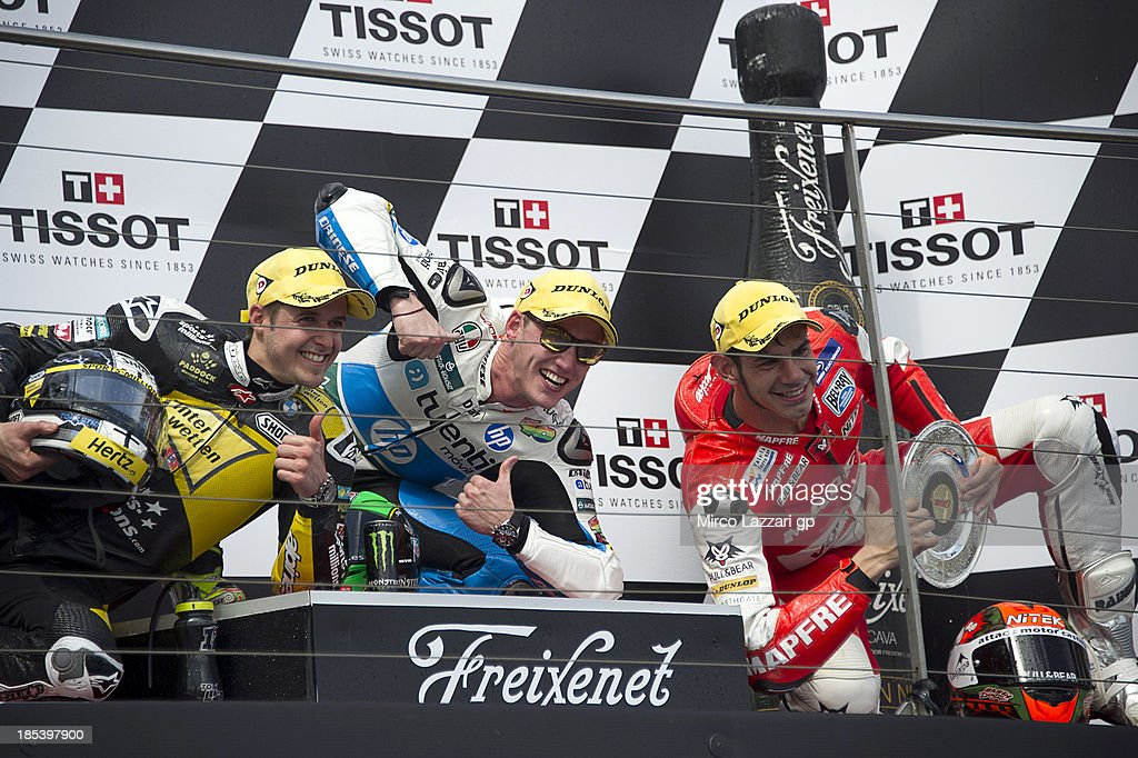 Thomas Luthi of Switzerland and Interwetten Paddock, Pol Espargaro of Spain and Pons 40 HP Tuenti and Jordi Torres of Spain and Aspar Team Moto2 celebrate at the end of the Moto2 race ahead of the Australian MotoGP, which is round 16 of the MotoGP World Championship at Phillip Island Grand Prix Circuit on October 20, 2013 in Phillip Island, Australia.
