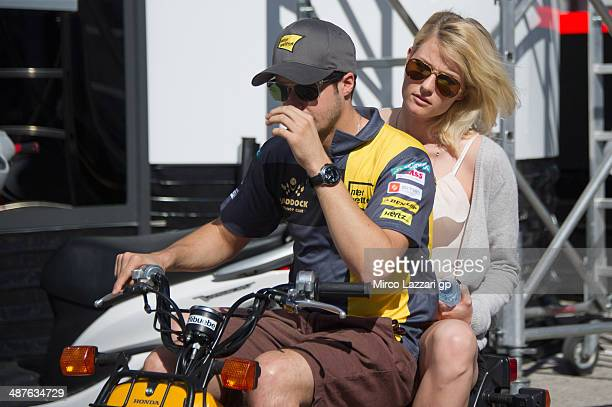 Thomas Luthi of Switzerland and Interwetten Paddock rides the scooter in paddock with girlfriend during the MotoGp of Spain Previews at Circuito de...