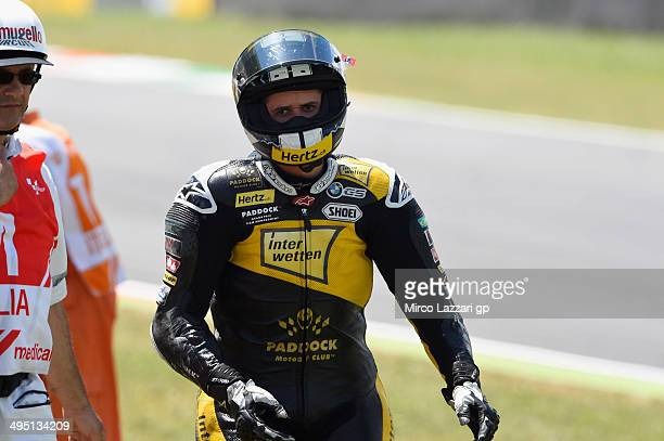 Thomas Luthi of Switzerland and Interwetten Paddock walks out of track after crashed out during the Moto2 race during the MotoGp of Italy Race at...