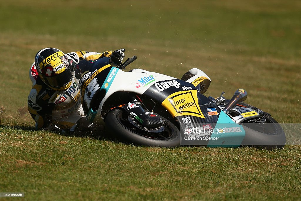 Thomas Luthi of Switzerland crashes during the Moto2 race during the 2015 MotoGP of Australia at Phillip Island Grand Prix Circuit on October 18, 2015 in Phillip Island, Australia.