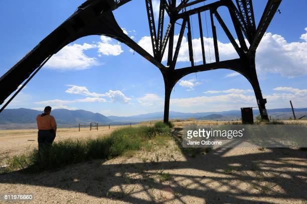 Thomas Malloy Reclamation Inspector for the ButteSilver Bow County Planning Department takes a call while standing under a gallows frame located near...