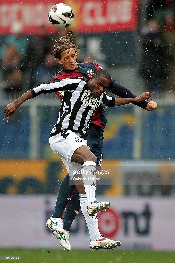 Thomas Manfredini of Genoa CFC fights for the ball with Innocent Emeghara of AC Siena during the Serie A match between Genoa CFC and AC Siena at Stadio Luigi Ferraris on March 30, 2013 in Genoa, Italy.