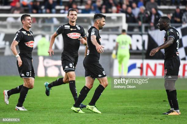 Thomas Mangani of Angers celebrates his goal with his team mates during the Ligue 1 match between Amiens SC and Angers SCO at Stade de la Licorne on...