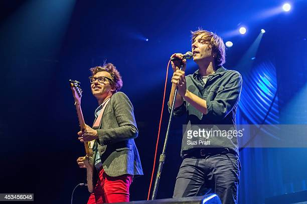 Thomas Mars and Christian Mazzalai of Phoenix perform live at Key Arena on December 3 2013 in Seattle Washington