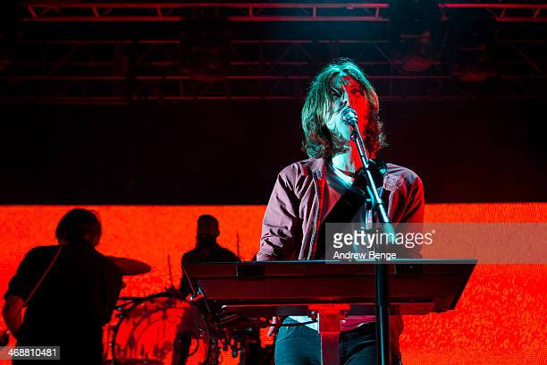 Thomas Mars and Deck D'Arcy of Phoenix perform on stage at Manchester Academy on February 11 2014 in Manchester United Kingdom