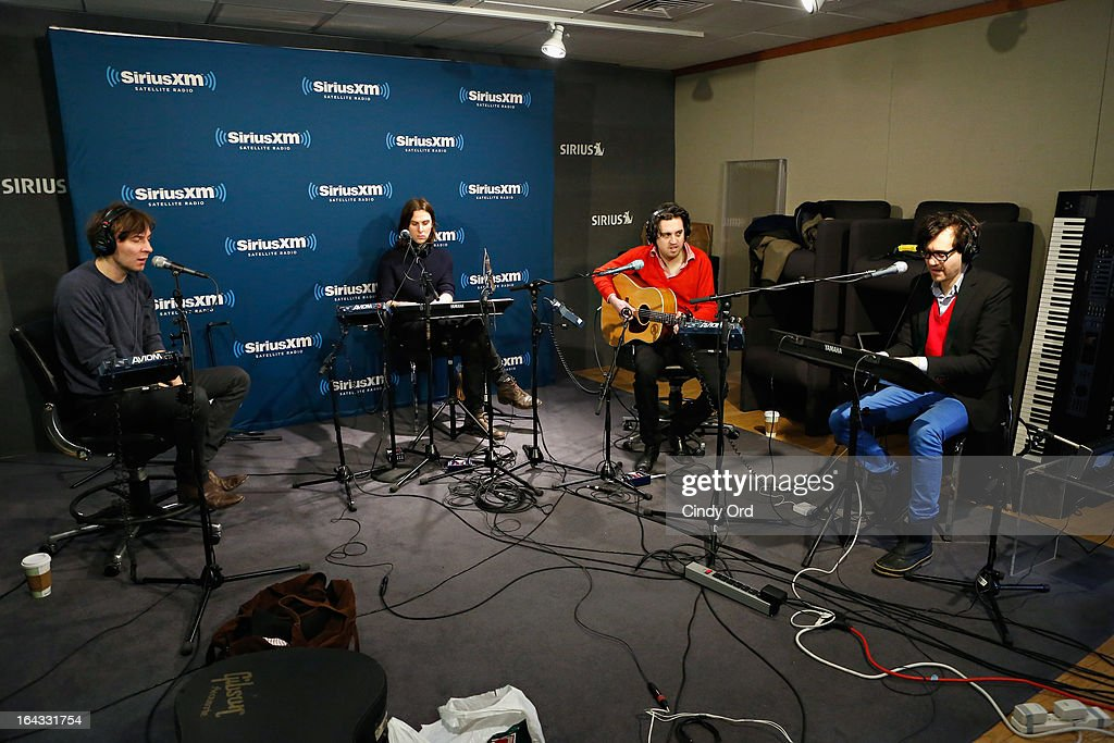 Thomas Mars, Deck d'Arcy, Christian Mazzala and Laurent Brancowitzi of Phoenix perform at the SiriusXM Studios on March 22, 2013 in New York City.