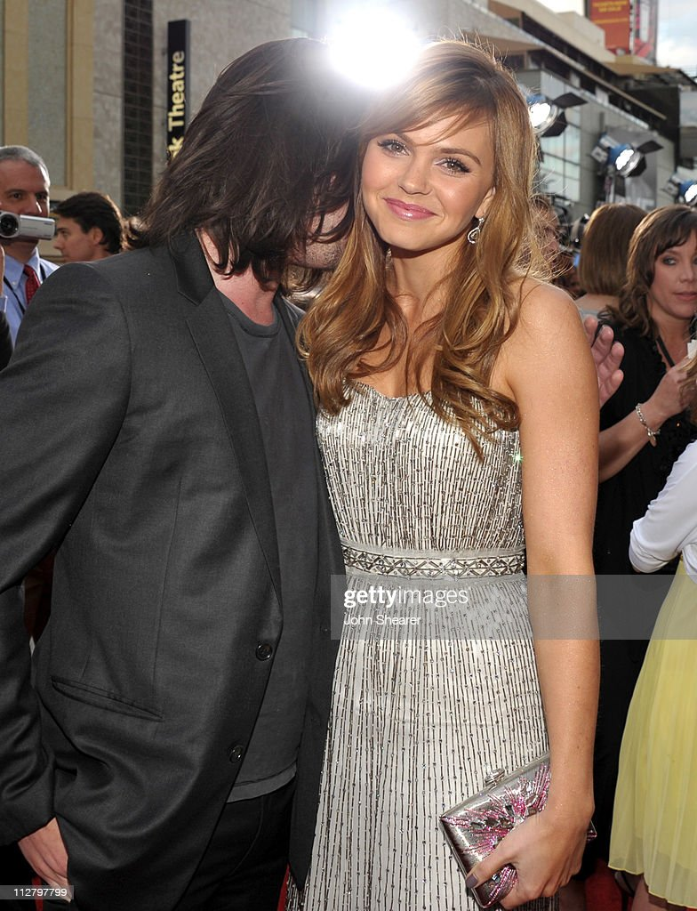 Thomas McDonell and Aimee Teegarden arrive to the 'Prom' World Premiere at the El Capitan Theatre on April 21, 2011 in Hollywood, California.